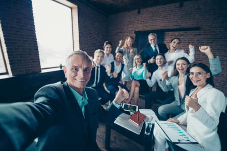 Foto de Self-portrait of nice stylish cheerful excited glad executive company staff showing thumbsup yes goal corporate culture agree advice at modern industrial loft interior work place space - Imagen libre de derechos
