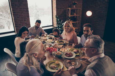 Photo pour Close up photo big large family thanksgiving conversation members company brother sister granny mom dad grandpa son daughter sitting round festive holiday full tasty dishes table loft house indoors - image libre de droit