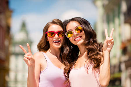 Photo pour Close up photo charming cute trendy pretty hairstyle best millennial travel trip long hair spring pastel clothing modern spec travel enjoy free time laugh make v-signs satisfied joy town center. - image libre de droit
