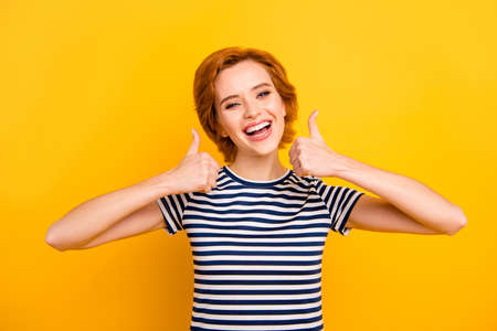 Photo for Close up photo beautiful amazing she her lady easy-going thumb up amazed glad advising new product wearing casual striped white blue t-shirt outfit clothes isolated yellow bright vibrant background - Royalty Free Image