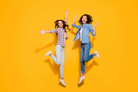 Foto de Full length body size view photo cute funny funky person beautiful free time weekends holidays travel spring summer raise hands arms fists long hair fool plaid modern outfit isolated yellow background - Imagen libre de derechos