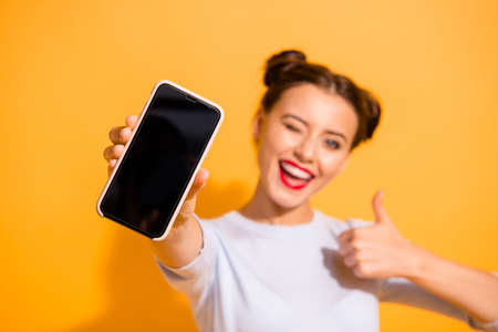 Foto per Close up photo of funky energetic student showing her mobile phone agreement appreciation wearing light cotton outfit on colorful background - Immagine Royalty Free
