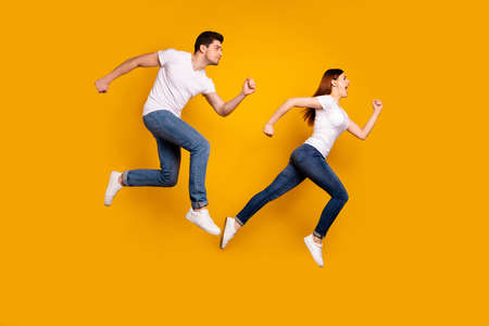 Photo pour Full length side profile body size photo funky funny she her he him his guy lady jump high hurry shopping black friday low prices wear casual jeans denim white t-shirts isolated yellow background - image libre de droit
