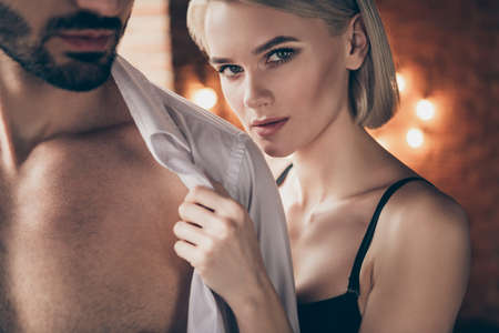 Foto de Cropped close up photo hot two people partners she her lady touch hands he him his handsome shoulders taking off white shirt wife husband anniversary morning full wish want eager house room indoors - Imagen libre de derechos