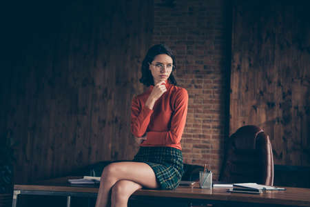 Photo pour Portrait of focused pensive lady real estate agent dream dreamy thought start up touch thin brunette hair hairstyle dressed casual checkered skirt cotton sweater industrial - image libre de droit