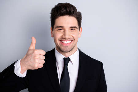 Photo pour Close up photo amazing he him his macho handsome hand arm thumb up advising buy buyer new tested great product wear white shirt black suit jacket tie formal-wear isolated bright grey background - image libre de droit