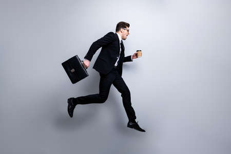 Foto de Full length body size profile side view portrait of nice classy attractive worried guy carrying in hands diplomat latte white collar rush hour career growth workplace isolated on light gray background - Imagen libre de derechos