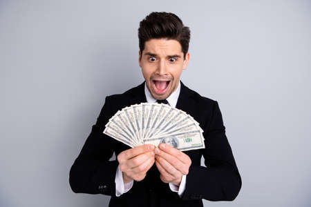 Photo pour Close-up portrait of his he nice attractive cheerful crazy emotional guy manager financier banker sales agent broker currency lottery credit loan lottery isolated over light gray background - image libre de droit