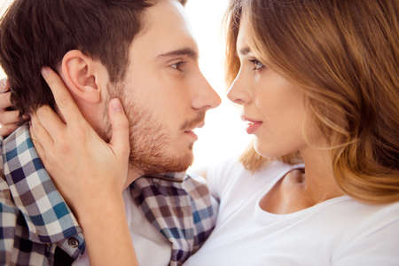 Photo pour Close-up cropped portrait of his he her she nice attractive charming bearded guy caressing lady ideal match life partners in light white style interior hotel house indoors - image libre de droit