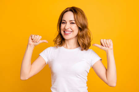 Photo pour Close up photo amazing beautiful she her lady thumbs indicate direct chest self-confident toothy I am best choice choose pick select me advice wear casual white t-shirt isolated yellow background - image libre de droit