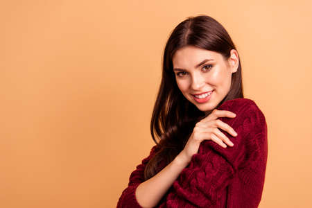 Foto per Close up photo beautiful amazing she her lady ideal appearance hands arms hold herself overjoyed warm clothes pure quality wear casual red burgundy knitted pullover isolated pastel beige background - Immagine Royalty Free