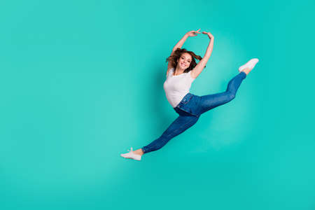 Full length body size view of her she nice-looking attractive lovely cheerful cheery sportive slim fit thin slender wavy-haired lady practicing hobby isolated on bright vivid shine blue background