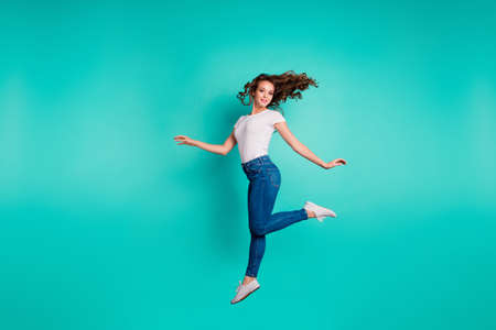 Photo for Full length body size view of her she nice attractive lovely feminine sweet sporty slim fit thin slender cheerful wavy-haired lady strolling isolated on bright vivid shine blue background - Royalty Free Image