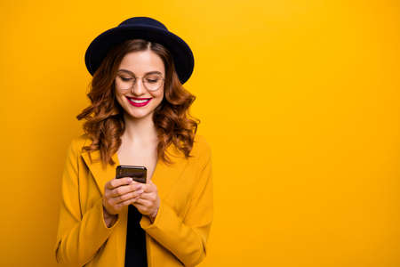 Photo pour Close up  beautiful she her toothy lady arms hands telephone check  followers perfect red lips pomade wear specs formal-wear costume suit isolated yellow vivid vibrant background - image libre de droit