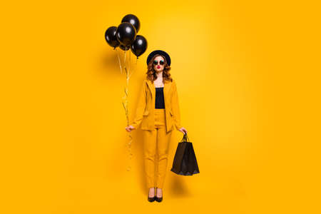 Photo for Full length body size photo beautiful she her lady send air kiss carry packs perfect look festive guest birthday presents balloons wear specs formal-wear costume suit isolated yellow bright background - Royalty Free Image