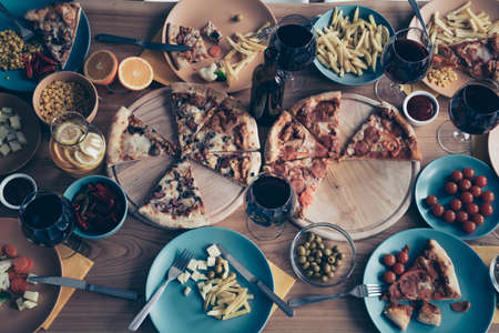 Close up top above high angle view photo holiday table full different dishes plates kitchen apply forks knifes no people woman man person inside loft room cafe restaurant indoors