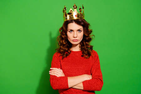 Photo pour Portrait of her she nice-looking lovely winsome pretty attractive serious bossy selfish wavy-haired girl in red sweater crown feminism isolated on bright vivid shine green background - image libre de droit