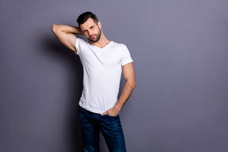 Portrait of gorgeous nice charming pretty man millennial he his good-looking touch head neck palm hand wear fashionable modern clothing isolated grey background