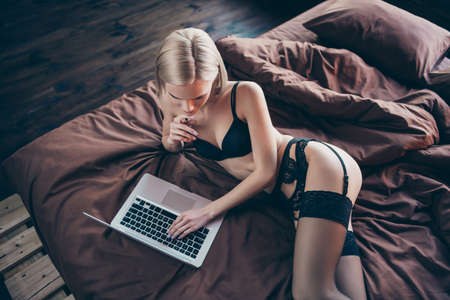 Photo for Top above high angle view of her she nice-looking graceful curvy luxury stunning gorgeous attractive feminine lovely lady lying on bed chatting with boyfriend on sheets linen - Royalty Free Image