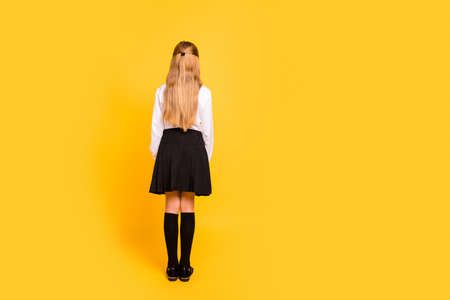 Foto de Rear back behind full length body size view of her she nice-looking, attractive straight-haired pre-teen girl standing still isolated on bright vivid shine yellow background - Imagen libre de derechos