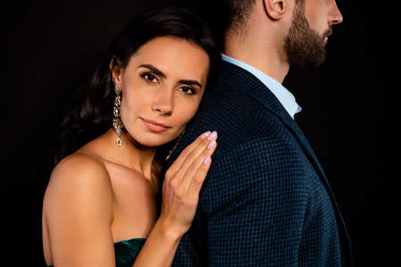 Photo pour Cropped close up side profile photo amazing pair she her classy he him his macho stand touch lean hands arms strong back tender wear blue costume jacket green velvet dress isolated black background - image libre de droit