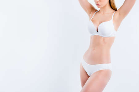Photo pour Cropped view of nice attractive adorable fit thin sportive gorgeous girl with healthy perfect figure medical clinic procedure liposuction fat burning isolated over light gray background - image libre de droit