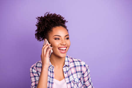 Portrait of positive cute pretty millennial have dialogue use device hear listen information words summer spring dressed plaid shirt have free time weekend holiday isolated on purple background