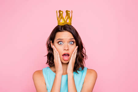 Close up photo beautiful she her lady attractive appearance hands arms cheekbones stupor staring golden headwear lose social status epic fail wear colorful blue dress isolated pink bright background