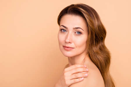 Photo pour Close up side profile photo beautiful amazing cute charming she her lady hold hand arm touch shoulder perfect condition soft purity result anti-age procedures nude isolated pastel beige background - image libre de droit