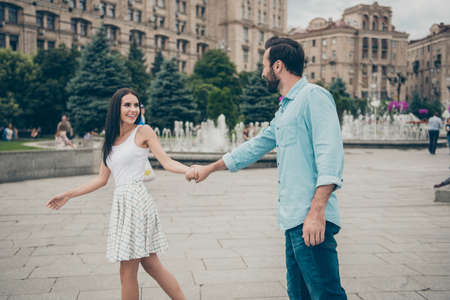 Photo for Profile side view photo of charming pretty lovely people promenade cheerful candid enjoy free time voyage tour wear dress white blue denim jeans shirt bearded - Royalty Free Image
