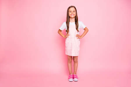 Photo pour Full body photo of little lady brown hair holidays leisure time hands sides wear rose sun dress t-shirt isolated pink background - image libre de droit
