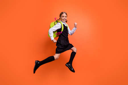 Photo for Full length body size view of nice attractive lovely cheerful cheery glad diligent pre-teen girl nerd running fast first grade back to school isolated on bright vivid shine orange background - Royalty Free Image