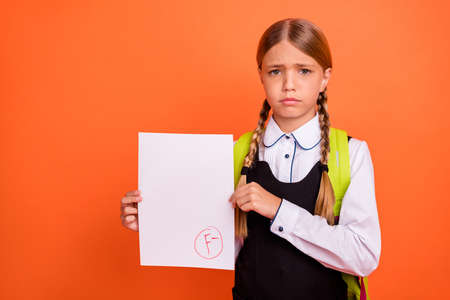 Photo pour Portrait of her she nice attractive lovely disappointed unlucky pre-teen blonde girl showing bad fiasco mark score first grade isolated on bright vivid shine orange background - image libre de droit