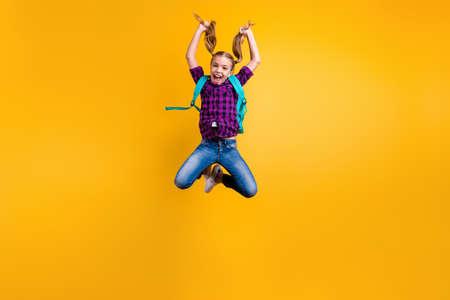 Foto de Full body photo of little pupil jump high finally holidays wear casual checkered shirt jeans denim isolated yellow background - Imagen libre de derechos