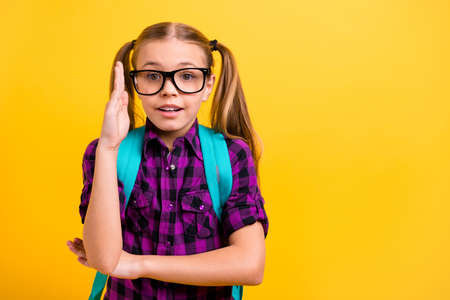 Foto per Close up photo of small lady pupil raise arm air lesson know answer wear specs casual checkered shirt isolated yellow background - Immagine Royalty Free
