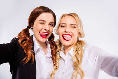 Photo pour Photo of two classmates ladies making selfies winking eyes wear shirts isolated white background - image libre de droit