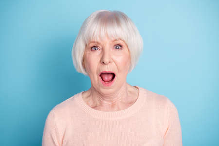 Photo pour Close-up portrait of nice attractive lovely well-groomed stunned healthy gray-haired lady opened mouth expression isolated over bright vivid shine blue green teal background - image libre de droit