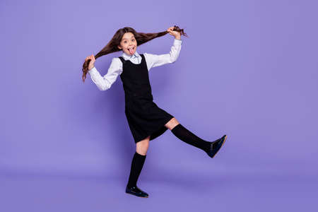 Foto de Full length body size view of her she nice attractive lovely cheerful cheery glad carefree wavy-haired pre-teen girl making tails having fun time isolated over bright vivid shine violet background - Imagen libre de derechos
