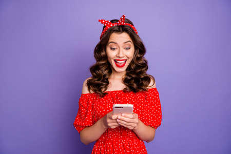 Foto per Pretty lady holding telephone hands open mouth from cool news wear old-fashioned dress isolated purple background - Immagine Royalty Free