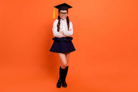 Photo for Full length body size view photo of cute charming kid content future bachelor exam pass hat headwear diploma lesson white shirt blouse boots eyewear trendy eyeglasses isolated orange background - Royalty Free Image