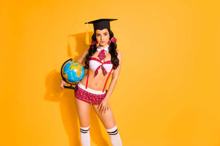Photo for Photo of lady perfect legs curly pigtails receive diploma geography faculty planet wear red bra skirt isolated yellow background - Royalty Free Image
