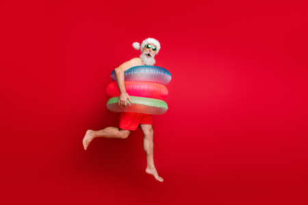 Photo pour Full length body size view of nice handsome cheerful cheery funky glad positive comic childish playful wondered bearded gray-haired man hurry rush isolated on bright vivid shine red background - image libre de droit