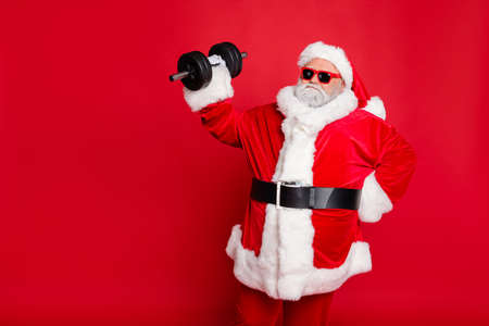 Photo for Portrait of his he nice attractive fat overweighed bearded Santa working out barbell physical exercise workout calories diet regime isolated over bright vivid shine red background - Royalty Free Image