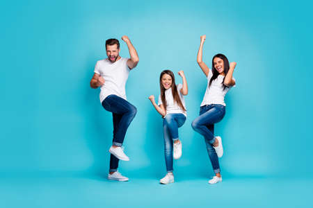 Photo pour Full body photo of daddy mommy and small lady raising fists air rejoicing wear casual outfit isolated blue background - image libre de droit