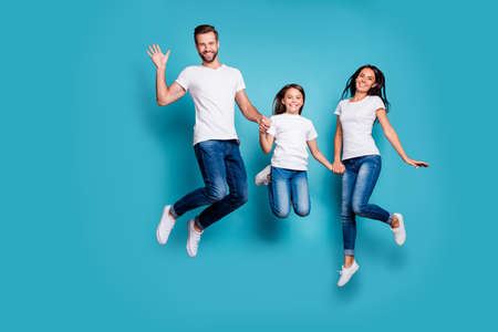 Foto de Full length body size photo of funny funky cheerful glad family jumping in front of camera while isolated with blue background - Imagen libre de derechos