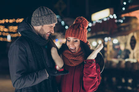 Foto de Be my wife. Portrait of his he her she nice attractive charming lovely, cheerful cheery glad delighted couple wearing warm outfit guy making life partnership proposal 14 February engage outdoors - Imagen libre de derechos
