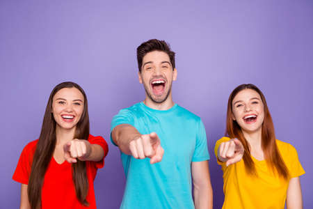 Photo for Portrait of nice-looking attractive lovely charming cheerful cheery funny guys wearing colorful t-shirts pointing at you laughing having fun isolated over violet lilac background - Royalty Free Image