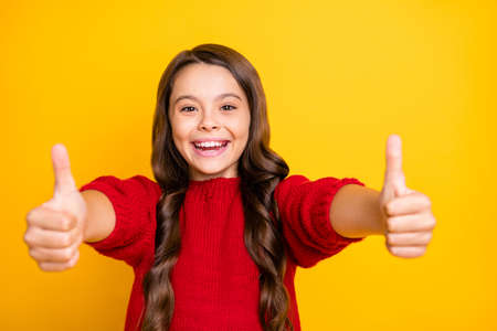 Photo pour Close up photo of positive cheerful emotion funky kid show thumb up enjoy ads give feedback choice decisions recommend promo wear style lifestyle jumper isolated over yellow color background - image libre de droit