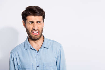 Ugh ew. Photo of amazing mixed race guy looking disgusted on spoiled food terrible smell wear casual denim shirt isolated white color background