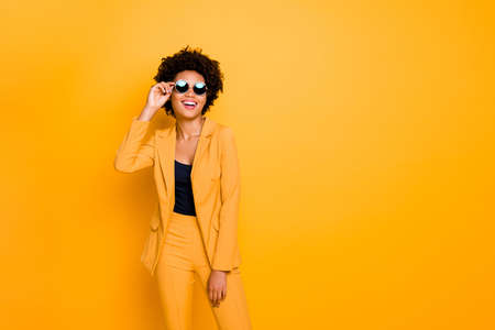 Photo for Portrait of her she nice fashionable attractive luxurious cheerful cheery wavy-haired girl touching specs isolated over bright vivid shine vibrant yellow color background - Royalty Free Image